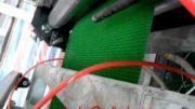 Artificial grass mat extrusion machine